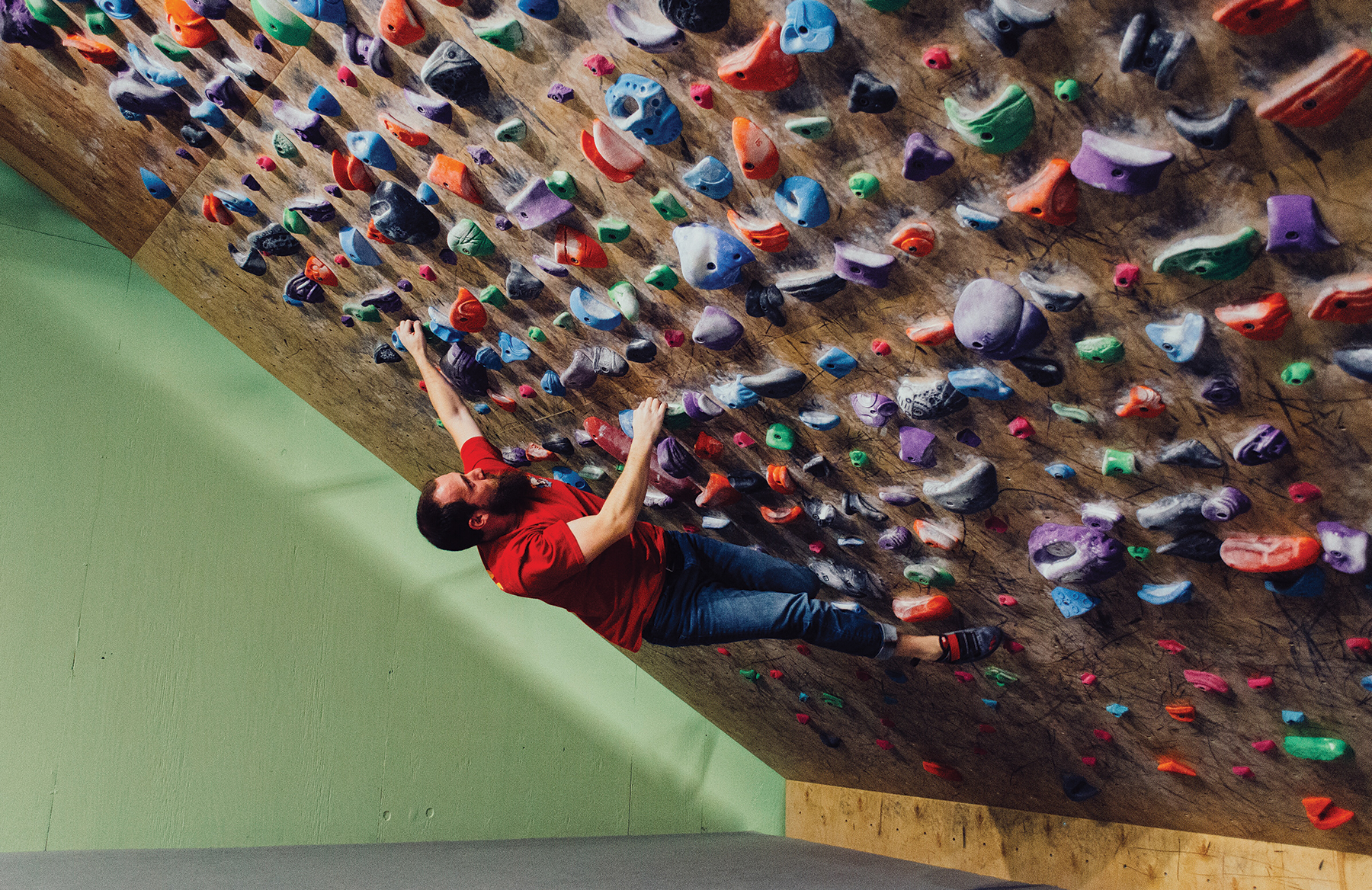 Rob Anderson on the 60 degree training wall at Climb So iLL.
