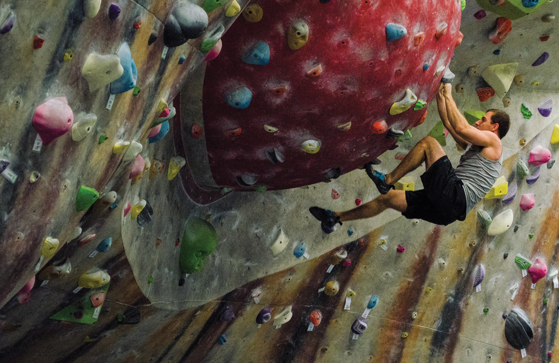 Josh Woods on the bouldering Eye Wall at Climb So iLL.